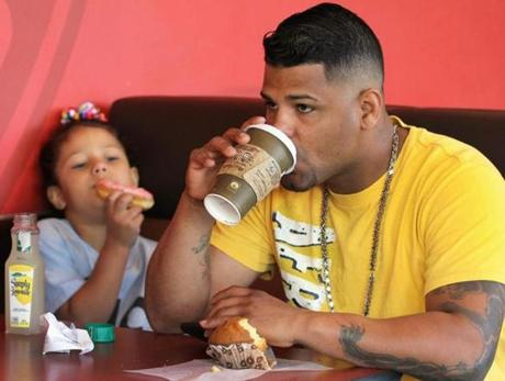 Reynaldo Albarado and his daughter, Yaxelis, 6, had breakfast at Dunkin' Donuts Wednesday.